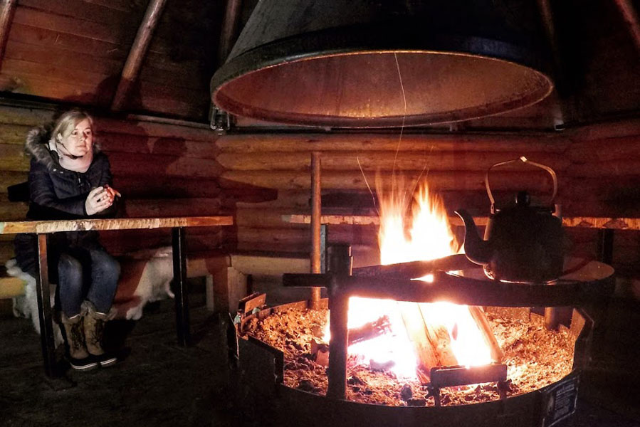 Having a warm drink in hut at Varjola, Kuusa, Finland - AllinMam.com