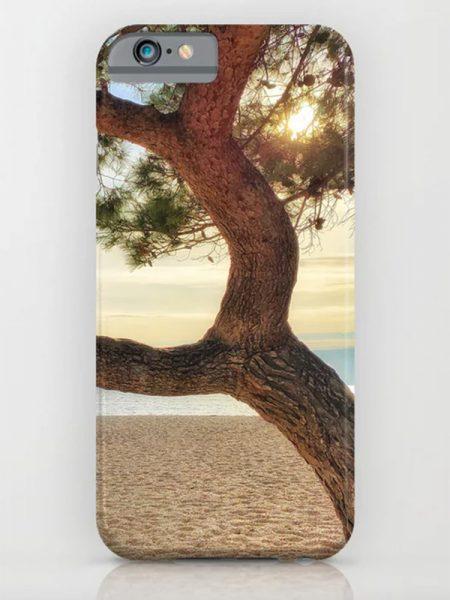 Telefoonhoesje met zonsondergang op strand - Reislegende.nl